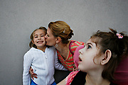 MELISSA LYTTLE       Times<br /> SP_351237_LYTT_TWINS_20 (March 30, 2012, Clearwater, Fla.) With a full parking lot and no handicapped spots available near the restaurant they ate dinner at, Allison Scheinman gives her daughter Hailey a kiss while waiting with Olivia for Jon to go get the minivan to pick them up. Because of her special needs, Olivia gets a lot of attention from her parents, so they say it's important to include Hailey in making family decisions and making sure she knows she's loved.  [MELISSA LYTTLE, Times]
