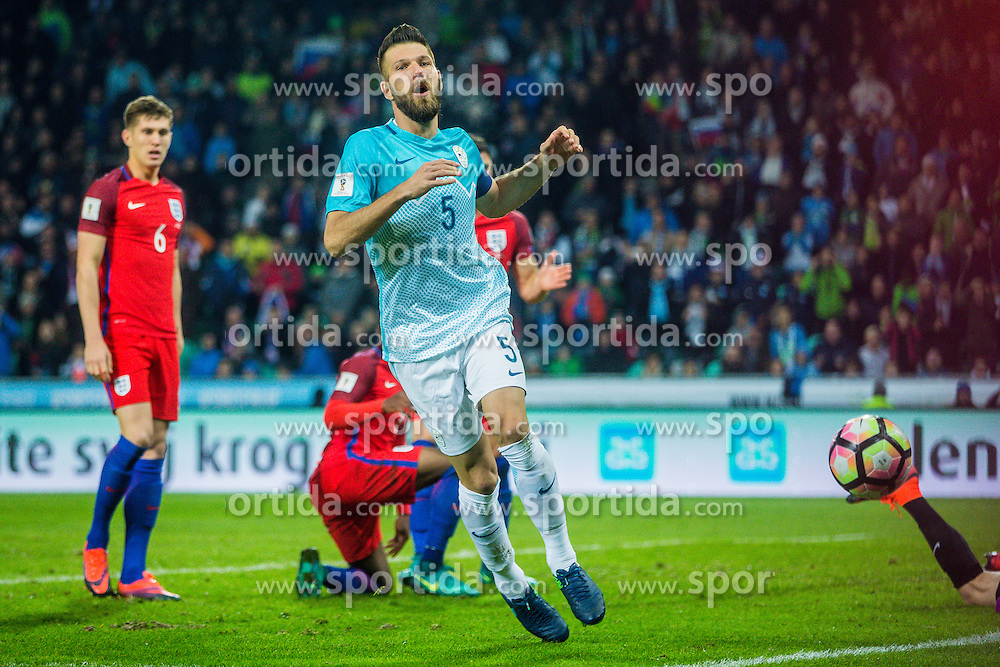 Bostjan Cesar of Slovenia and John Stones of England during football match between National teams of Slovenia and England in Round #3 of FIFA World Cup Russia 2018 qualifications in Group F, on October 11, 2016 in SRC Stozice, Ljubljana, Slovenia. Photo by Grega Valancic / Sportida