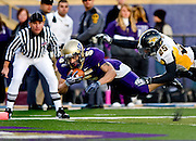 James Madison's Bosco Williams dives across the goal line for a touchdown during third quarter action against Towson at Bridgeforth Stadium in Harrisonburg on Saturday..