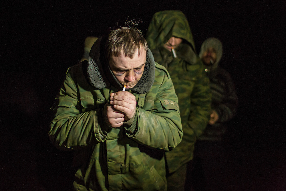 NOVOTOSHKIVSKE, UKRAINE - FEBRUARY 21: Pro-Russian rebels, released as prisoners of war during a prisoner exchange with Ukrainian forces, walk between opposing front lines back to rebel territory on February 21, 2015 in Novotoshkivske, Ukraine. Ukrainian forces withdrew from the strategic and hard-fought town after being effectively surrounded by pro-Russian rebels, though fighting has caused widespread destruction.