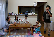 The Kanno family has a very positive attitude to life but it is underlined by the fear of radiation and the effect it can have on their three children as their house is located in an area of Date city that has dangerous radiation levels and residents were recommended to voluntarily evacuate as the local government would offer them houses in other areas of Date with less radiation. The Kanno family is waiting for such a house and they hope they can get it as soon as possible so that they can move. Til then children have to play indoors and when going out of the house they have to be fully covered and wear masks.