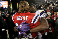 Minnesota Vikings wide receiver Randy Moss gives a hug to his former teammate, New England Patriots quarterback Tom Brady at the end of the game at Gillette Stadium in Foxboro, Massachusetts on October 31, 2010.  The Patriots defeated the Vikings 28-18.    UPI/Matthew Healey