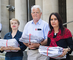 Ministry of Defence, Westminster, July 18th 2016. A petition with over 40,000 signatures is handed in to the Ministry of Defence, calling for the abandonment of the Trident Nuclear deterrent programme ahead of a debate on the issue in Parliament. PICTURED: Kate Hudson from CND, left, Kent Bruce from CND and SNP MP Margaret Ferrier pose outside the Ministry of Defence with the petition.