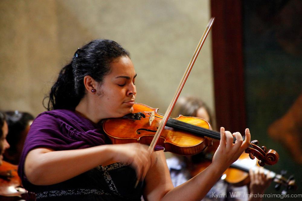 "Central America, Cuba, Havana. Violinist of Cuban Orchestra ""Camerata Romeu"" rehearses in Basilica Menor de San Francisco de Asis."