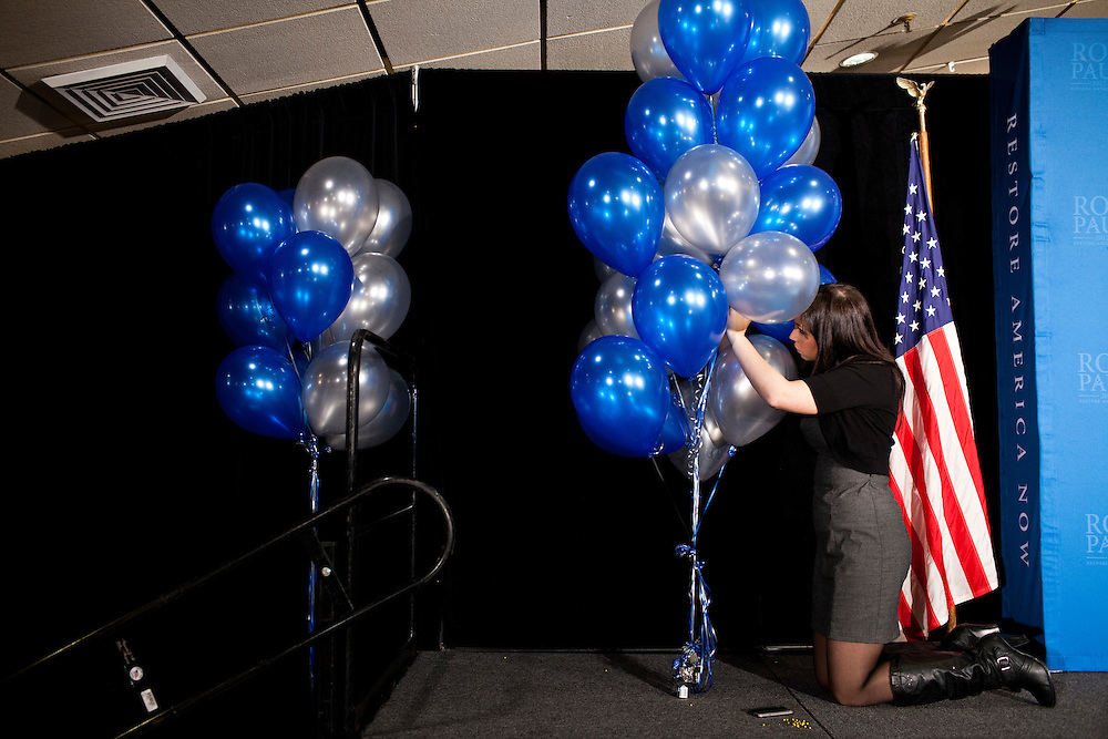 Allison Gibbs, an advance staffer for the campaign of Republican presidential candidate Ron Paul, preps the stage for a primary night rally at the Executive Court banquet facility on Tuesday, January 10, 2012 in Manchester, NH. Brendan Hoffman for the New York Times