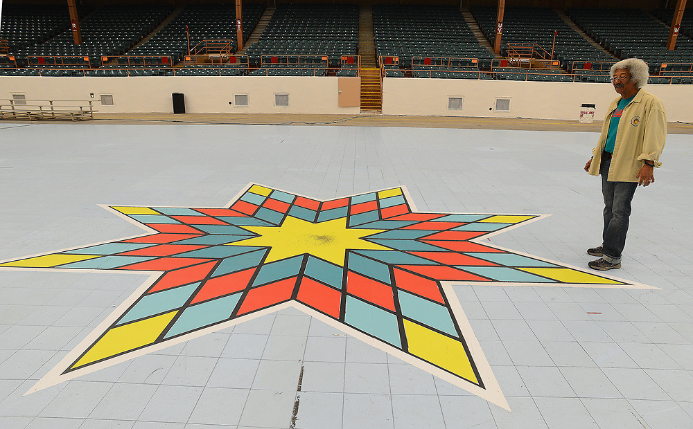 apl042517d/ASECTION/pierre-louis/JOURNAL 042517<br /> Founder Derek Mathews,,inspects a Sioux Star on the dance floor at Tingley Coliseum  in preparation for the Gathering of Nations Pow Wow at Expo New Mexico.Photographed on Tuesday April 25, 2017. .Adolphe Pierre-Louis/JOURNAL