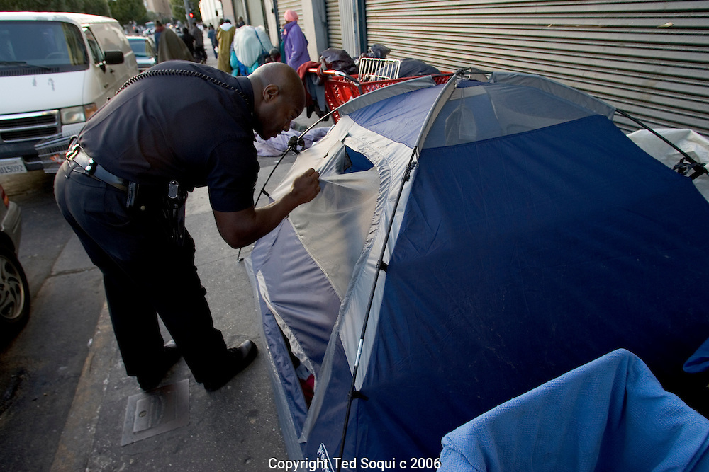 LAPD Senior Lead Officer Deon Joseph checks out a small homeless encampment on Downtown LA's skid row.