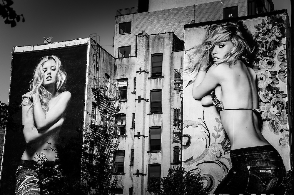 Huge billboards with giant blonde girls on the walls of a building in SoHo, Manhattan, New York, 2009.