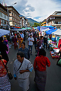 BU00016-00...BHUTAN - Locals in traditional dress visiting the festival market during the Thimphu Drubchen (festival).