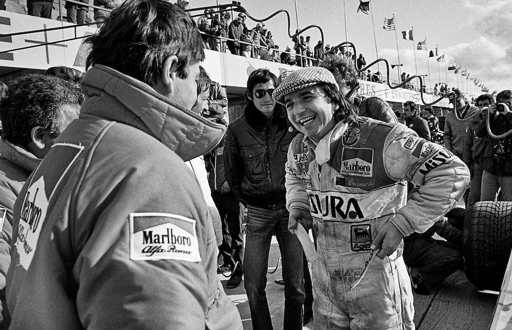 Formula One Marlboro-Alfa Romeo driver Bruno Giacomelli's surprise pole position for the 1980 United States Grand Prix, helped somewhat to restore the team's spirits following the death of French driver and team leader Patrick Depailler while testing the car for the German Grand Prix earlier that summer. Depailler had been rejuvenating the team's racing heritage and Giacomelli had responded with better qualifying performances.<br /> <br /> He would take the lead of the race immediately and hold it, repeating perfect laps until the Alfa Romeo engine stopped 28 laps from the finish; it's Magnetti Marelli &quot;black box&quot; control unit had failed.
