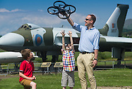 Brian McCall and his two sons Bruce (9) and Fraser (6) get close up to a Parrot AR Drone 2.0 as they look forward to celebrating Father&rsquo;s Day at the Robots Live event at the National Museum of Flight on Sunday 15th June.  The event will feature a talk and demo on Drones: Robots of the Skies, along with robot battles, fun activities and science demonstrations on a range of robotic action<br /> <br /> For more information contact Rebecca at StonehillSalt PR on 01620 829 800 or 07970 783213.<br /> <br /> Picture by Alex Hewitt<br /> alex.hewitt@gmail.com<br /> 07789 871540
