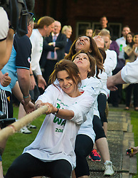 Westminster, London, June 6th 2016. Female MPs pull against the McMillans wonen's team as teams from uk industry as well as the House of Commons and the House of Lords compete in the annual McMillan Cancer Charity tug o' war. PICTURED: Jo Cox, front,  in the House of Commons women's team during this year's Parliamentary tug-of-war.