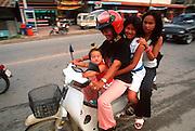 THAILAND, SOUTH, PHUKET ISLAND Phuket town, motor scooter transportation