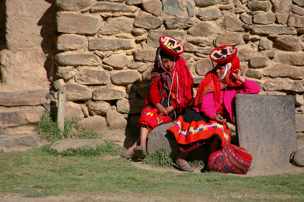 South America, Latin America, Peru, Urubamba Valley. Quechua Women rest in the sun in Ollantaytambo.