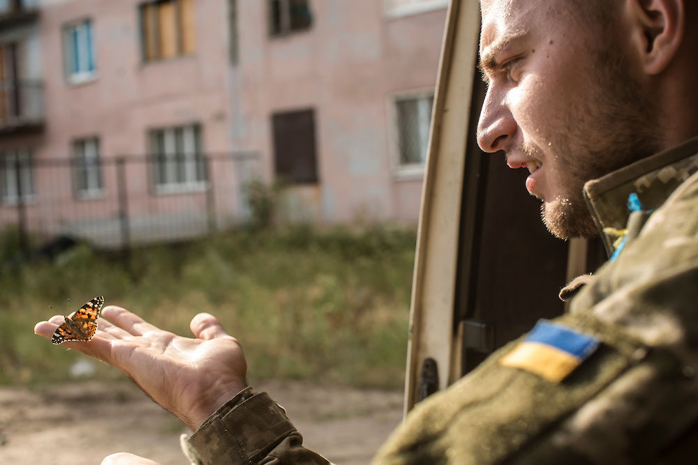 AVDIIVKA, UKRAINE - JULY 9, 2016: Lt. Denis Naumov, a Ukrainian Army press officer with the 58th brigade, with a butterfly in Avdiivka, Ukraine. The town is now one of the most active areas of fighting along the line of control between the Ukrainian government and Russian-backed rebels. CREDIT: Brendan Hoffman for The New York Times