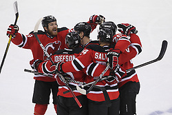 May 21, 2012; Newark, NJ, USA; The New Jersey Devils celebrate a goal by New Jersey Devils defenseman Bryce Salvador (24) during the first period in game four of the 2012 Eastern Conference Finals at the Prudential Center.