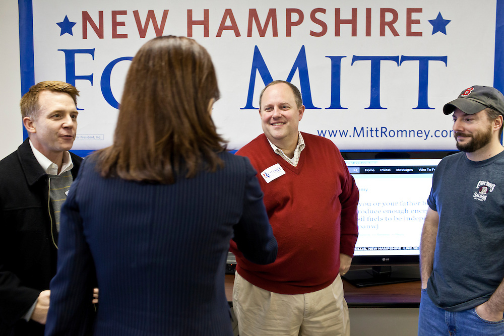 Sen. Kelly Ayotte (R-NH), second from left, greets staff at the New Hampshire campaign headquarters of Republican presidential candidate Mitt Romney on Monday, January 9, 2012 in Manchester, NH. Brendan Hoffman for the New York Times