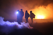 In Laase police clashed with about 2.000 people beside the transport route of 11 trucks delivering high radioactive waste to Gorleben. protesters light straw fires to gain lots of smoke to hinder police from acting