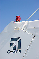 Detail of a red navigation light on the tail (vertical stabilizer) of a Cessna 172 light plane