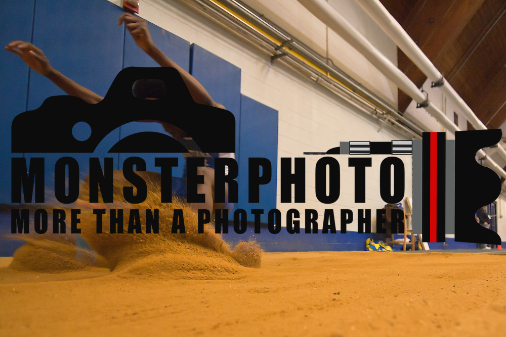 021211 Newark DE: Christiana Junior Kehinde Akojie shown landing in the sand during triple jump event at the state indoor track and field championships at The University of Delaware Field House in Newark Delaware Saturday afternoon...Special to The News Journal/SAQUAN STIMPSON
