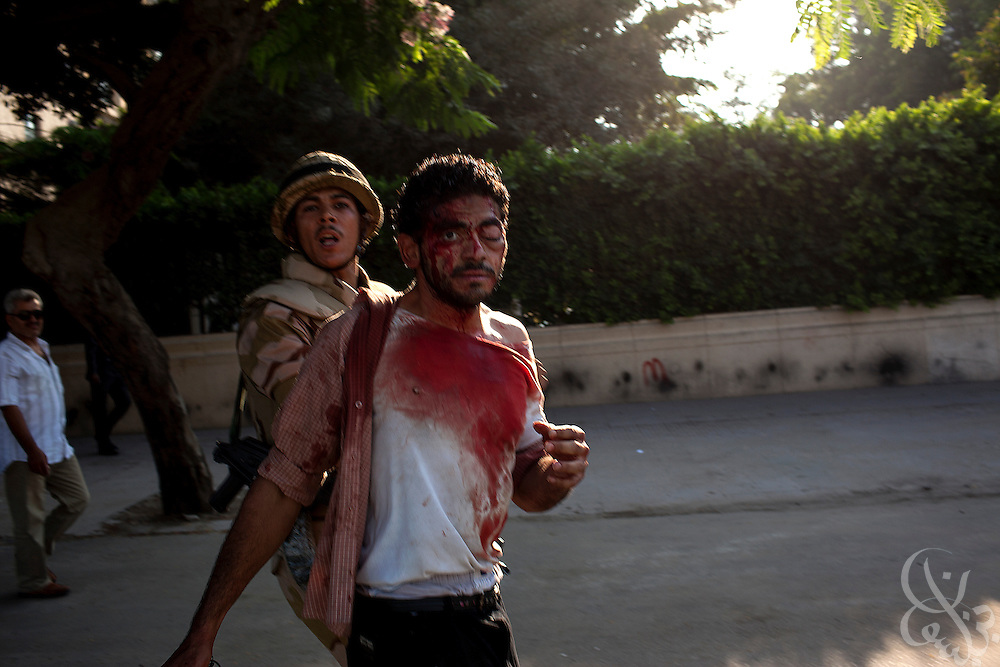 Soldiers detain a wounded supporter of  deposed President Mohamed Morsi during violent clashes between Pro and anti-Morsi factions July 22, 2013 in Cairo, Egypt that have claimed at least one life in the capital. The clashes began when Pro-Morsi demonstrators marched close to Tahrir square, where dozens of Anti-Morsi demonstrators remain camped out, sparking dangerous running battles throughout the neighborhood that claimed at least one life and wounded dozens of others. Supporters from both sides mainly threw rocks at each other, but a few from both sides had and used pistols and shotguns during the clashes.