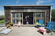 Claudia Steinberg and Barbara Epler bought this wooden house in Jamaica Bay, Rockaway, and turned it into an artful weekend escape.<br /> Rockaway Beach, Queens, New York, USA..Rockaway is making a comeback for New Yorkers who share the endless beach with the locals on weekends. Rockaway Beach is  also one of the favorite spots for surfers on the East Coast, a stretch of the beach is reserved exclusively for them. <br /> Rockaway Beach, Queens, New York, USA, <br /> <br /> Photo &copy; Stefan Falke<br /> www.stefanfalke.com<br /> stefanfalke@mac.com<br /> 917-2149029