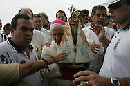 Belem do Para's bishop holds the 28 cm high saint: it is the Lady of Nazareth, worshipped by two million people in this procession on each second Sunday of October. It has been this way for 212 years.