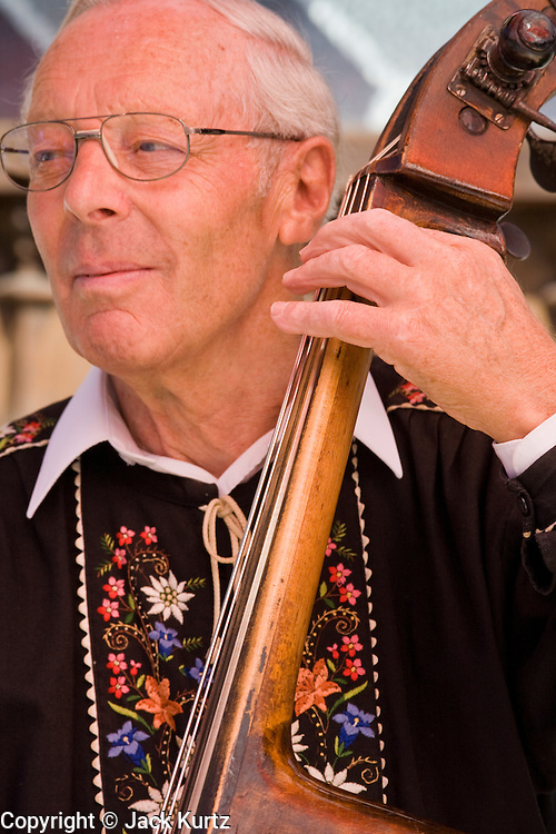 01 AUGUST 2007 -- INTERLAKEN, BERN, SWITZERLAND: A stand up bass player performs during Swiss National Day celebrations in Interlaken, in the canton of Bern, Switzerland. Swiss National Day is the Swiss national holiday and celebrates the founding of the Swiss confederation 716 years ago, in 1291. There are parades, fireworks shows and bonfires throughout the country.  PHOTO BY JACK KURTZ