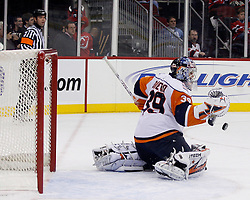 November 16, 2007; Newark, NJ, USA; New York Islanders goalie Rick DiPietro (39) makes a save during the second period of their game against the New Jersey Devils at the Prudential Center in Newark, NJ.