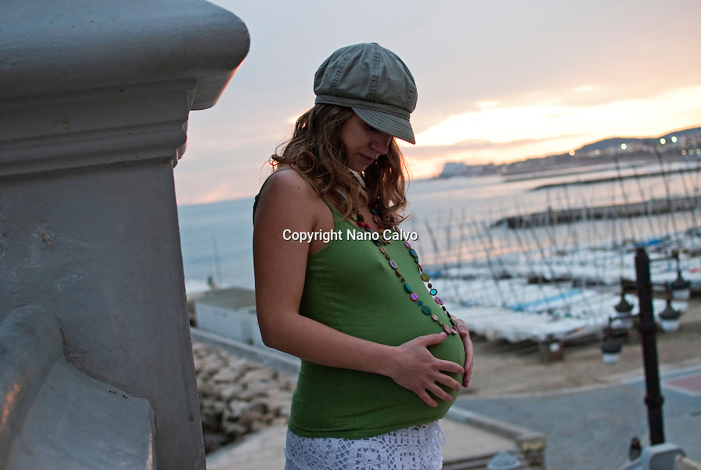 Young attractive pregnant woman at 8 months