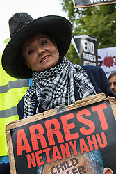 Whitehall, London, September 9th 2015.  Pro Palestinian and Israeli counter-protesters clash in Whitehall as the Palestinian Solidarity campaign demands the arrest of Israel's PM Benyamin Netanyahu for war crimes in the 2014 war with Palestinians in Gaza.  // Contact: paul@pauldaveycreative.co.uk Mobile 07966 016 296