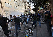 Hundreds of Egyptian protesters flee in panic as clashes with nearby security forces resume following the breakdown of a very brief ceasefire between the two sides November 22, 2011 near Tahrir square in central Cairo, Egypt. Thousands of protestors demanding the military cede power to a civilian government authority clashed with Egyptian security forces for a fourth straight day in Cairo, with hundreds injured and at least 29 protestors killed so far.  (Photo by Scott Nelson)