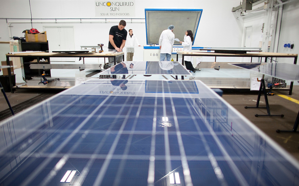 London, Ontario ---11-04-19--- David Binder Jr., left, frames a solar panel at Unconquered Sun Solar Technologies in Tecumseh, Ontario, April 19, 2011.<br /> GEOFF ROBINS The Globe and Mail