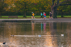 Regent's Park, London, November 4th 2014. A group of runners enjoy the early morning sunshine in Regents Park.