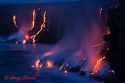 hot lava from the 61G flow, emanating from Pu'u O'o on Kilauea Volcano, flows over sea cliffs into the ocean at the Kamokuna ocean entry in Hawaii Volcanoes National Park, Kalapana, Puna, Hawaii ( the Big Island ), Hawaiian Islands, U.S.A. ( Central Pacific Ocean )