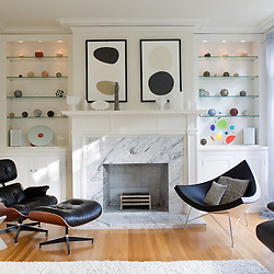 Contemporary living room in private home featuring Eames lounge chair and ottoman (left) and Nelson coconut chair (right,San Francisco, California