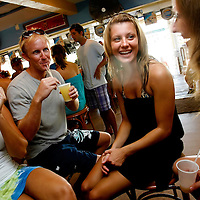 SIESTA KEY, FL -- August 22, 2009 -- Cani Frerichs, left ro right, of Sarasota, Fla., Martin Rivenbark of Sarasota, Lauren Squires of St. Petersburg, and Shayla Twit of Sarasota share a laugh over frozen mixed drinks at the massive daquiri bar the Daquiri Deck on Siesta Key in Sarasota, Fla., on Saturday August 22, 2009.  Summer is becoming a more popular time to visit Siesta Key out of season with shorter lines, cheaper rates, and more room to plop a towel and umbrella down in said sand.