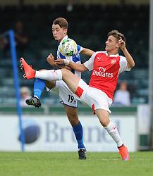 Arsenal's Vlad Drogmir challenges Jay Malpas of Bristol Rovers - Photo mandatory by-line: Dougie Allward/JMP - Mobile: 07966 386802 - 18/07/2015 - SPORT - Football - Bristol - Memorial Stadium - Pre-Season Friendly
