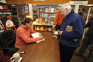 "Retired St. Louis Cardinals manager Tony La Russa signs copies of his book ""One Last Strike"" for David Knight at Square Books in Oxford, Miss. on Thursday, November 29, 2012."