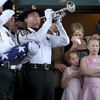 CAPTION: (Hudson 05/16/2006) Pasco Sheriff's Deputy Jason Marques (cq archive) performs Taps as Deputy Aaron Buffardi (cq) wife, Kelly Buffardi  and daughters, Bailey Buffardi (cq), 7, left, and Madison (cq), 9,  watch as (Aaron) Buffardi's casket is placed in a hearse following his funeral Tuesday morning at First United Methodist Church of Hudson. Buffardi, a popular courthouse bailiff, died in a motorcycle accident Friday (5/12/06).  SUMMARY:The funeral for Pasco Sheriff's Deputy Aaron Buffardi, a popular bailiff at the courthouse who died in a Friday morning motorcycle accident, is 11 a.m. Tuesday at First United Methodist Church at 13123 U.S. 19. It's more of a private service. The deputy was cremated, and this won't be the typical law enforcement funeral. This is live for Wednesday's Times. Thanks.