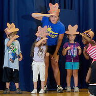 "Middletown, New York -  Children and a counselor from the Middletown YMCA's Camp Funshine perform in ""The Show"", a musical production, on Aug. 7, 2014."