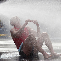 Middletown, New York - Donald Thurston of Pine Bush cools off after running in Orange Regional Medical Center's Run 4 Downtown road race on Aug. 16, 2014. All the proceeds from the Run 4 Downtown go to revitalizing Middletown's Historic district.