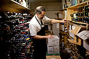 Rick Mindermann inspects a stash of wines stored at Cort Bros. in Sacramento, Calif., March 3, 2012.