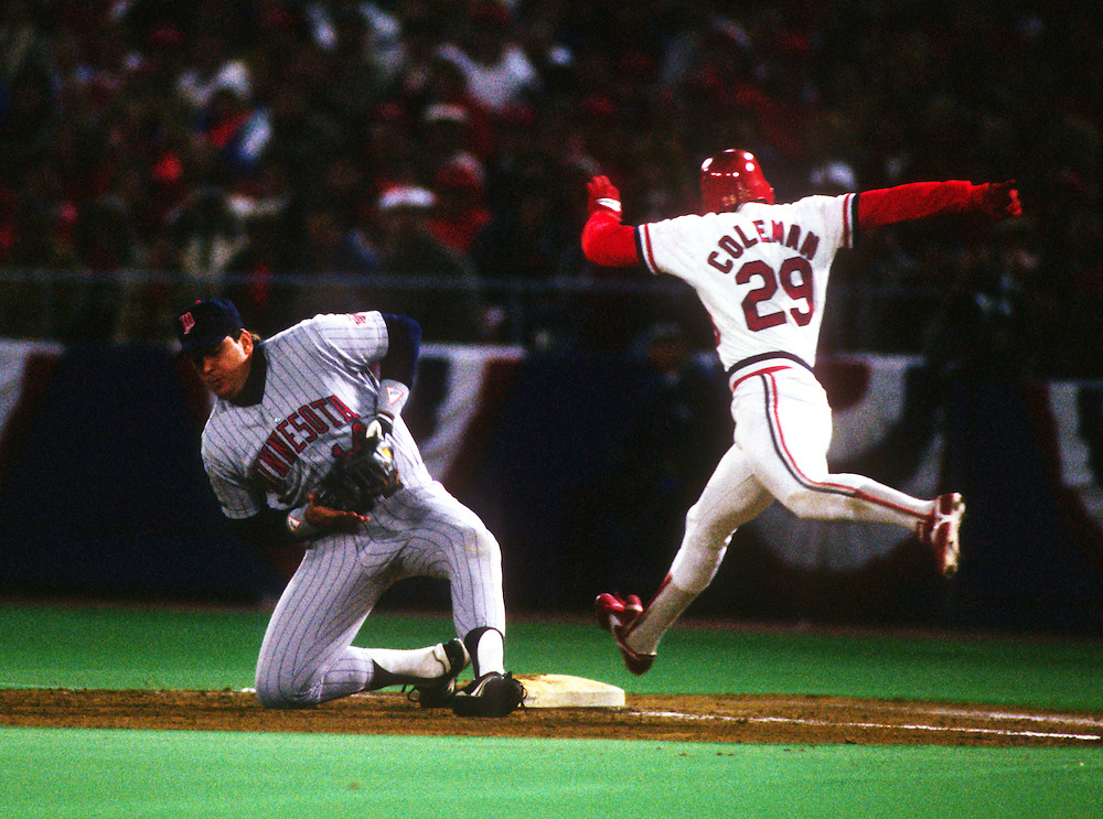 ST. LOUIS, MO-OCTOBER 1987: Minnesota Twins first baseman Kent Hrbek fields a low throw to first base as Vince Coleman of the St. Louis Cardinals is called out on the play during the 1987 World Series between the Twins and Cardinals at Busch Stadium in St. Louis, Missouri.  (Photo by Ron Vesely)