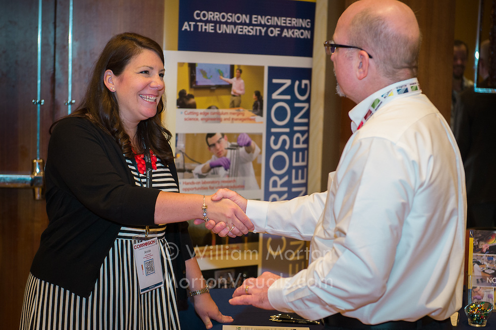 Annie Hanson from the University of Akron welcomes a NACE member at the BP Career Fair. Photography by Dallas event photographer William Morton of Morton Visuals event photography.