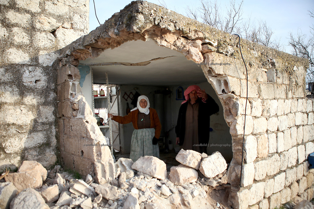An old couple inspect their destroyed house, after a tank of syrian troops crashed it by driving through. On 22. February the syrian army attacked the village of Kureen, Province of Idlib, Syria. Kureen was among the first villages in the northwest of Syria controlled by the opposition. Some villagers and members of the defence units escaped to surrounding olive orchards, when the attack begun in the early morning. A majority of the inhabitants didn´t manage to escape. The heavy shelling lasts 7 houres. Soldiers searched all houses, burnt some of them down, loote shops, stole cars and furniture. About 60 motorcycles were burnt down. Tanks demolished several houses. 6 men were executed. One woman died as a result of an heart attack.