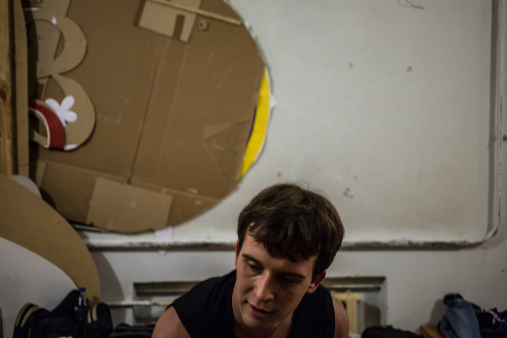 """Nikolai Ross, 25, rehearses an acrobatic act back stage at the local arts center on Tuesday, November 12, 2013 in Asbest, Russia. Ross works at the Uralasbest asbestos factory in town, among the largest producers of the chrysolite form of asbestos in the world. Ross carries the title """"Best Guy of the Factory"""" for 2013 and serves on the city's youth council."""