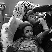 Raheem would comfort Saleh in his hospital bed until he fell asleep. Raheem lost his oldest son, Dia, in the explosion that maimed Saleh and did not have the heart to tell Saleh his older brother had died.