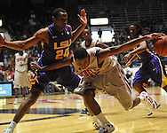 "Ole Miss' Jarvis Summers(32) vs. LSU's Storm Warren (24) at the C.M. ""Tad"" Smith Coliseum in Oxford, Miss. on Saturday, February 25, 2012. (AP Photo/Oxford Eagle, Bruce Newman)..."