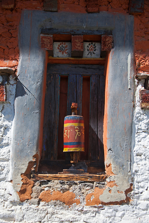 Asia, Bhutan, Bumthang. Prayer wheel at Jambay Lhakhang, a Buddhist temple dating back to the 7th century.